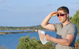 Male tourist with map. Male tourist with map on vacation Stock Photography