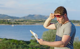 Male tourist with map. Male tourist with map on vacation Stock Photos