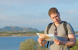 Male tourist with map. Male tourist with map on vacation Stock Images