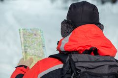 Male tourist with map in hand. View from back Royalty Free Stock Photo