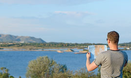Male tourist with map. Place for text. Royalty Free Stock Photos