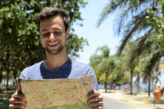 Male tourist with map. Travel lifestyle: male tourist with map Stock Photo