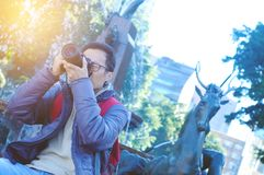Male tourist photographer. Male tourist taking picture in the city Stock Images