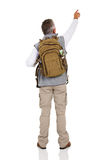 Male tourist pointing. Rear view of male tourist pointing at empty copy space Stock Image