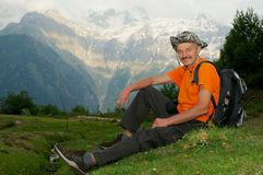Male tourist on the rest in mountains. European male tourist on the rest in mountains Stock Photography