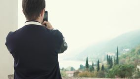 Male tourist shooting nature. stock video
