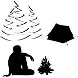 Male tourist  sitting near campfire and tent Stock Photography