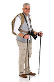 Male tourist standing. Healthy male tourist standing on white background Stock Photo