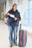 Male tourist. Standing with travel suitcase Royalty Free Stock Photography