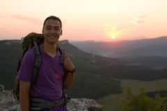 Male tourist at sunrise. Smilling tourist on sun rise Royalty Free Stock Images