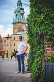 Male tourist takes picture in historic city Royalty Free Stock Photography