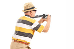 Male tourist taking a photo with camera. Isolated against white background, rear view Royalty Free Stock Images