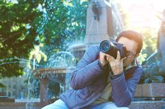 Male tourist photographer. Male tourist taking picture in the city Royalty Free Stock Image