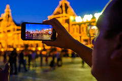 Male tourist taking picture of landmarks. By smart phone at night Royalty Free Stock Photography