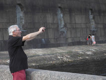 Male tourist taking pictures of the sights and makes a selfie in the summer. Saint-Petersburg. Peter and Paul fortress. The summer Royalty Free Stock Photography