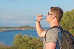 Male tourist tired. Drinking water Stock Photos
