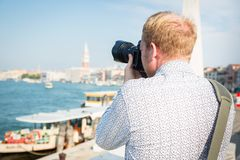 Tourist To Venice Taking Pictures Royalty Free Stock Photography