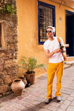 Male tourist walking in the old town. A man talking on the phone on vacation and texting Stock Images