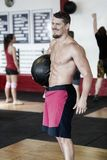 Male Trainer Carrying Medicine Ball Stock Photo
