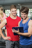 Male trainer discussing about performance Royalty Free Stock Image
