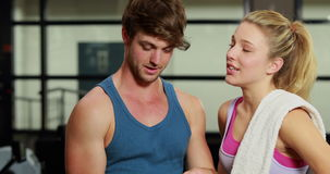 Male trainer discussing about performance. In crossfit gym stock video footage