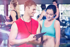 Male trainer discussing about performance. In gym Royalty Free Stock Image