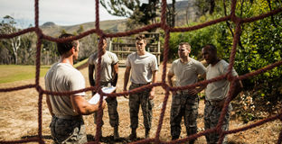 Male trainer instructing soldiers. In the bootcamp Stock Images