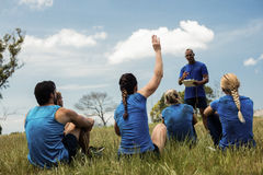 Male trainer taking attendance. In the bootcamp Stock Images