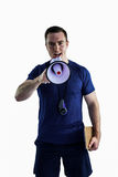 Male trainer yelling through the megaphone Royalty Free Stock Image