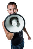 Male trainer yelling through megaphone Stock Photography