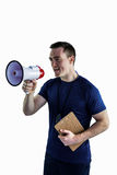 Male trainer yelling through the megaphone Royalty Free Stock Photo
