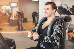 Man training in gym body health fit care. Male training in gym body workout back exercise Stock Image