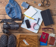 Male travel set. On a wooden table Royalty Free Stock Photos