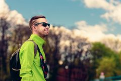 Male traveler with backpack. Portrait of handsome young man walking outdoors with backpack Stock Photo