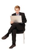 Male traveler busy on laptop. Young handsome male traveler busy on laptop while in transit Royalty Free Stock Photo