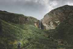 Male traveler climbs the mountain, concept of hiking, travel and adventure stock images