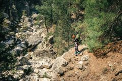 Hiker in the wild nature on the trail to Tahtali. Male traveler shot from above exploring rocks and rivulet on a sunny day in Turkey Stock Photos