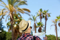 Male traveler standing outside with map Royalty Free Stock Photo