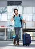 Male traveler talking on mobile phone Royalty Free Stock Photos