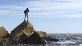 Male traveler. Young male traveler with photo camera on the beach stock video footage
