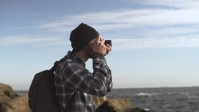 Male traveler. Young male traveler with photo camera on the beach stock video