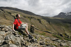 Male traveller. Young male traveller, photographer resting and enjoying the beautiful view of mountains in Iceland Royalty Free Stock Photo