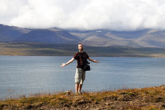 Male traveller. Young male traveller, photographer enjoying the beautiful view of mountains and ocean in Iceland Royalty Free Stock Photos