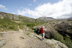 Male traveller. Young male traveller, photographer taking photos and hiking in Icelandic mountains Stock Photo