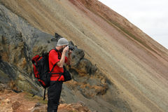 Male traveller. Young male traveller, photographer taking photos of the beautiful view of mountains in Iceland Royalty Free Stock Images