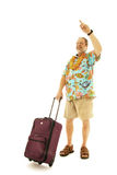 Male traveller hailing a taxi. Senior man dressed in tropical tourist clothes with suitcase hailing a cab isolated on a white background Royalty Free Stock Photo
