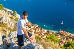 Male traveller looking at the panorama of Dubrovnik and sea. Male traveller looking at the panorama of the old city of Dubrovnik from the mountain. Travel to Stock Photos