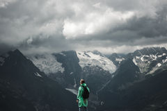 Male traveller and summer mountain stormy Royalty Free Stock Images