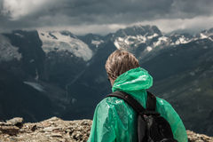 Male traveller and summer mountain stormy. Male traveller on the top of mountain stormy landscape Stock Photo