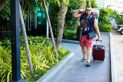 Male travels with a lot of bags and luggage. stock photography